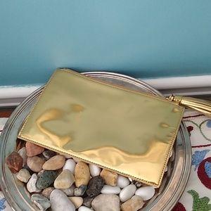 Loeffler Randell, leather gold clutch.